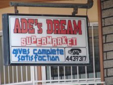 Ades supermarket and hotel sign in Hillsborough Carriacou.