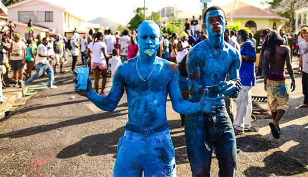 Blue painted revellers at Carriacou carnival.