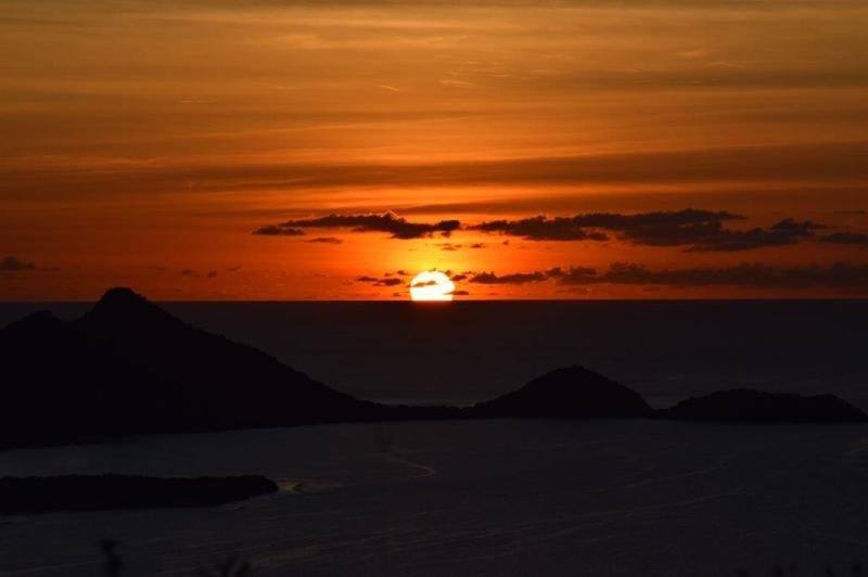 Sunrise over Belair and Petit Martinique in the background..