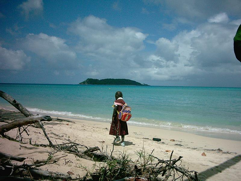 Walking along Paradise beach to school.