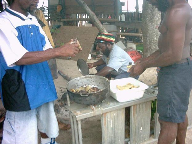Locals on Carriacou cooking a fish stew.